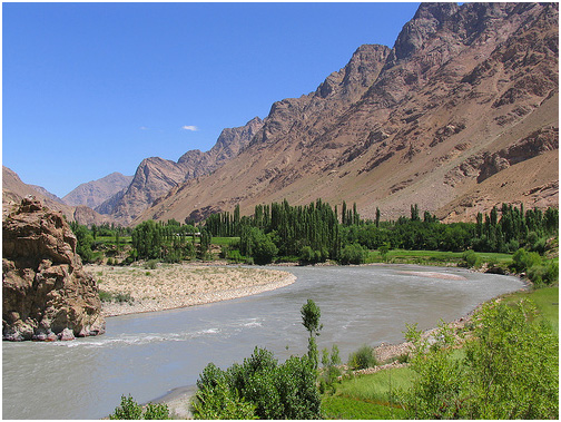 Panj River's Wakhan Valley & farms. The Panj River is called the Amu Darya (Oxus) in Afghanistan